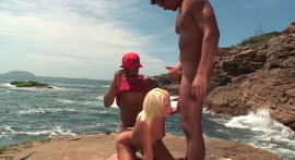 Double penetration in hot blonde on the beach rocks