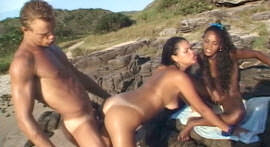 Threesome with two lesbians and one lucky on the beach