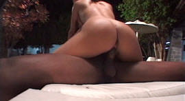Hot redhead doing interracial sex in the pool
