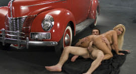 Pamela Butt shows all his talent next to an old car